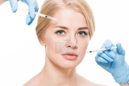 Photo for Cropped shot of young woman receiving beauty injections in face isolated on white - Royalty Free Image