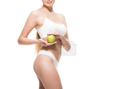 Photo for Cropped shot of beautiful slim girl in white underwear holding apple isolated on white - Royalty Free Image