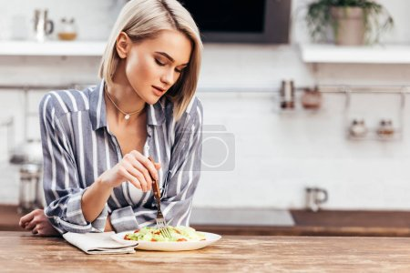 Photo for Selective focus of attractive woman eating salad - Royalty Free Image