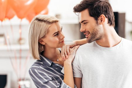 Photo for Selective focus of handsome boyfriend and attractive girlfriend standing in kitchen on Valentines day - Royalty Free Image