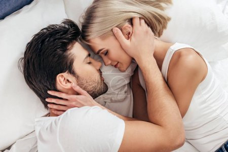Photo for Attractive girlfriend and handsome boyfriend laying in bed with closed eyes - Royalty Free Image