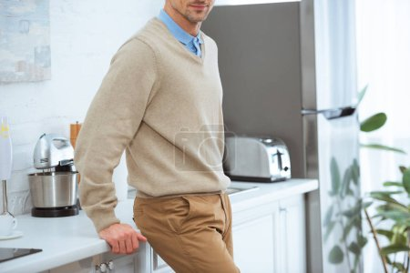 Photo for Cropped view of man in casual clothes near kitchen counter in morning with copy space - Royalty Free Image