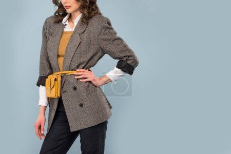 Photo for Cropped view of stylish woman in formal wear posing isolated on grey with copy space - Royalty Free Image