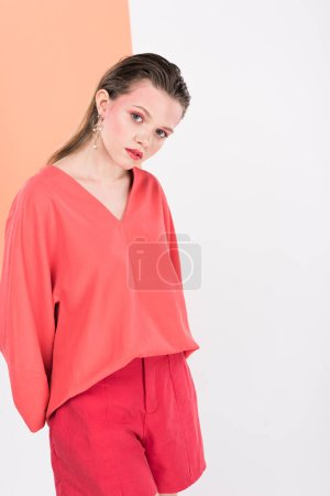 Photo for Beautiful fashionable girl posing with living coral and copy space on background - Royalty Free Image