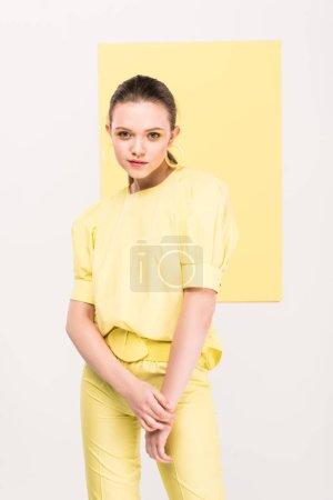beautiful fashionable girl posig with limelight on background