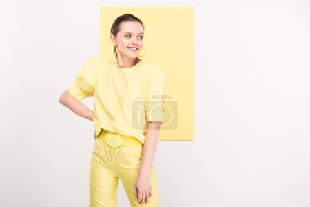 Photo for Beautiful stylish girl with hand on hip posig with limelight on background - Royalty Free Image
