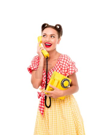 Photo pour Smiling pin up girl talking on vintage yellow phone - image libre de droit