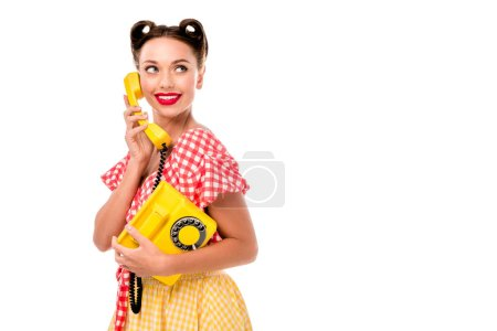 Photo pour Attracive pin up girl talking on vintage yellow phone - image libre de droit