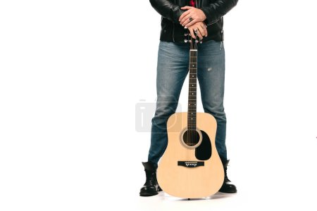 Photo for Cropped view of male musician in black leather jacket holding acoustic guitar, isolated on white - Royalty Free Image