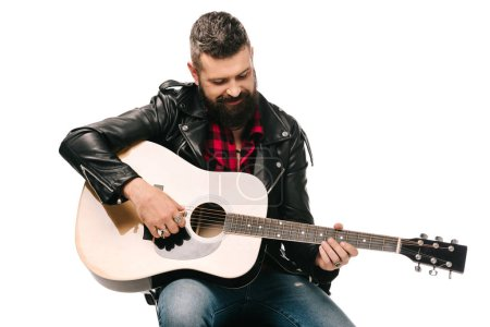Photo for Handsome male musician in black leather jacket playing on acoustic guitar, isolated on white - Royalty Free Image