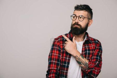 Photo for Stylish bearded man pointing isolated on grey - Royalty Free Image
