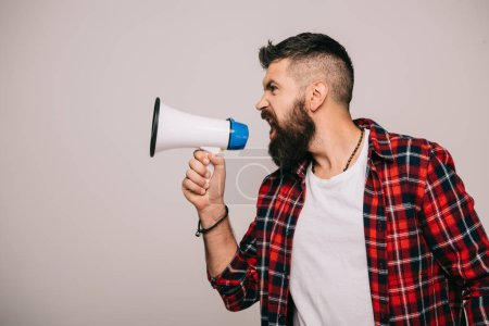 Photo for Angry bearded man in checkered shirt screaming into megaphone, isolated on grey - Royalty Free Image
