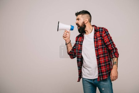 Photo for Angry handsome man shouting into megaphone, isolated on grey - Royalty Free Image