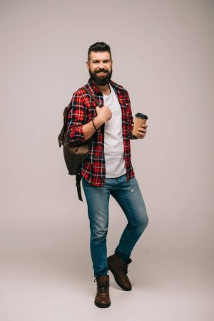 Photo for Happy bearded man in checkered shirt holding coffee to go isolated on grey - Royalty Free Image