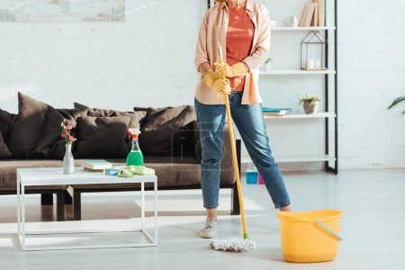 Photo for Cropped view of woman cleaning house with mop and bucket - Royalty Free Image