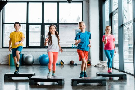 Photo for Active preteen children training with step platforms - Royalty Free Image