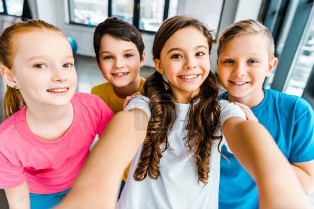 Photo for Excited preteen kids laughing while taking selfie together - Royalty Free Image