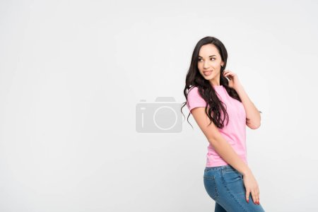 Photo for Cheerful girl standing and smiling isolated on grey - Royalty Free Image