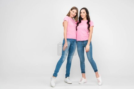 Photo for Attractive girls standing together on grey background - Royalty Free Image