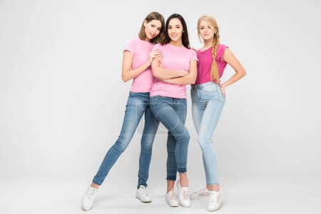 Photo for Happy women standing near friend with crossed arms on grey background - Royalty Free Image