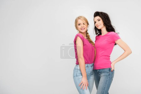 Photo for Attractive friends smiling while standing isolated on grey - Royalty Free Image