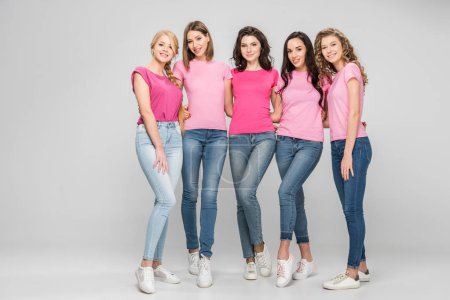 Photo for Cheerful young women standing together on grey background - Royalty Free Image