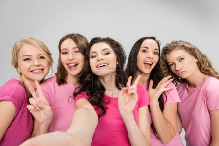 Photo for Funny young women taking selfie and showing peace signs isolated on grey - Royalty Free Image
