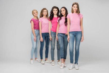 Photo for Beautiful young women standing together on grey background - Royalty Free Image