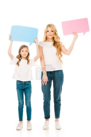 Photo for Pretty mother and cute child holding speech bubbles isolated on white - Royalty Free Image