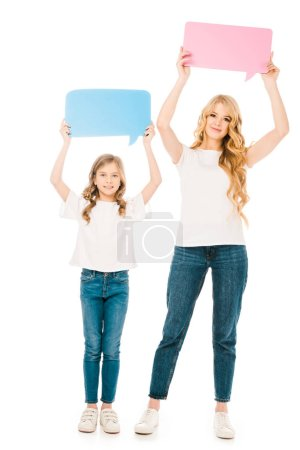 Photo for Beautiful woman with adorable daughter holding speech bubbles in raised hands isolated on white - Royalty Free Image
