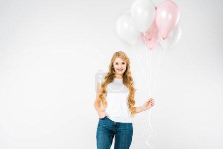 Photo pour Belle femme main dans la poche tenant des ballons à air blanc et rose sur fond blanc - image libre de droit