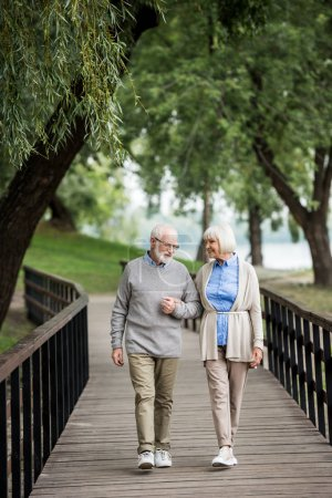 Photo for Nice senior couple enjoying walking in park - Royalty Free Image