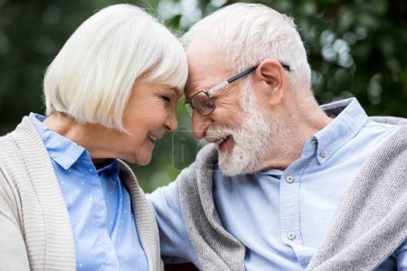 Photo for Happy senior couple smiling while touching with heads - Royalty Free Image