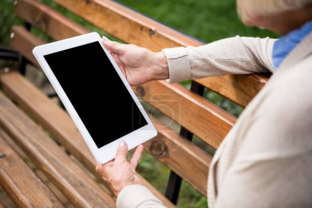 Photo for Selective focus of digital tablet with blank screen in hands of senior woman - Royalty Free Image