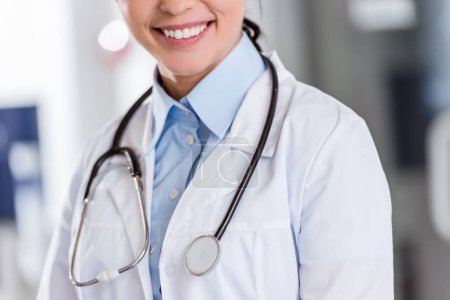 Photo for Cropped view of smiling female doctor with stethoscope - Royalty Free Image
