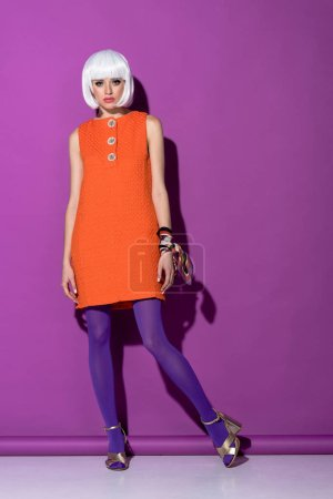 Photo for Full length view of wonderful girl in white wig standing on purple background - Royalty Free Image