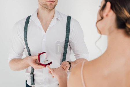 Photo for Cropped view man in white shirt making wedding proposal to young woman - Royalty Free Image