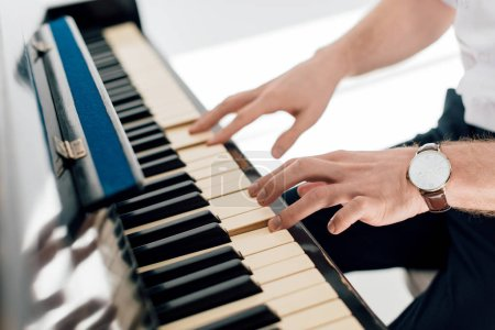 Photo for Selective focus of musician man playing piano - Royalty Free Image