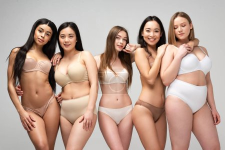 Photo for Five attractive young multiethnic women in underwear posing at camera isolated on grey, body positivity concept - Royalty Free Image