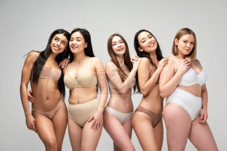 Photo for Five smiling pretty multicultural girls isolated on grey, body positivity concept - Royalty Free Image