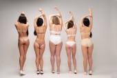 """Постер, картина, фотообои """"вернуться мнение пяти многонациональное женщины в белье с поднятыми руками, тело позитивность концепции"""""""