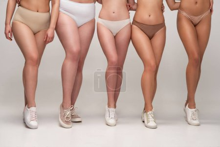 Photo for Cropped view of five multicultural women in underwear and sneakers, body positivity concept - Royalty Free Image