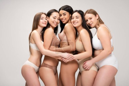 Photo for Five happy multiethnic women hugging while posing at camera isolated on grey, body positivity concept - Royalty Free Image