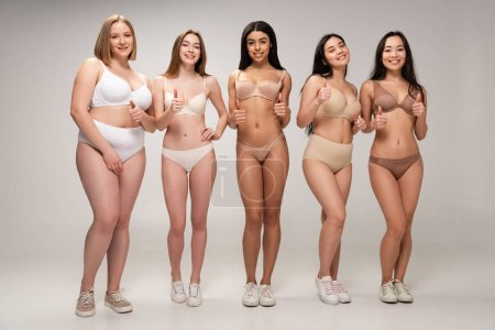 Photo for Five pretty multicultural young women in lingerie showing thumbs up, body positivity concept - Royalty Free Image