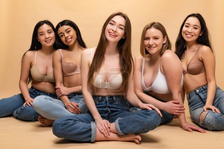 Photo for Five cheerful multicultural women sitting and looking at camera, body positivity concept - Royalty Free Image