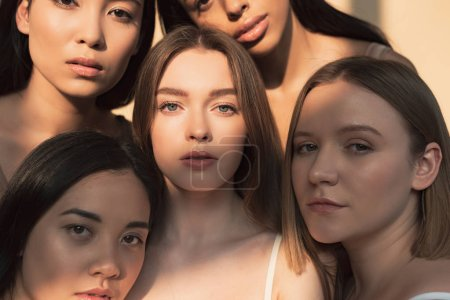Photo for Five beautiful multicultural girls looking at camera in sunlight - Royalty Free Image