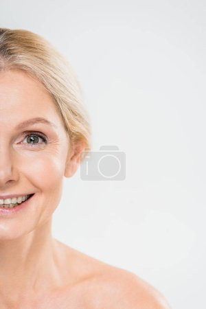 Photo for Partial view of smiling mature woman looking at camera isolated on grey - Royalty Free Image
