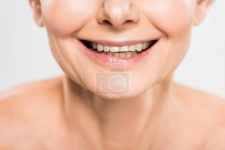 Photo for Partial view of mature and smiling woman isolated on grey - Royalty Free Image