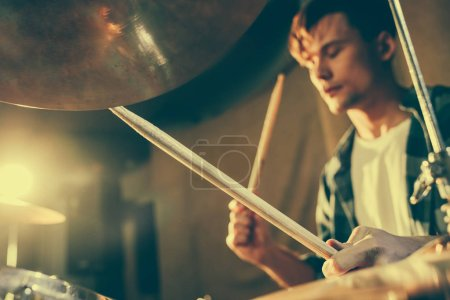 Photo for Selective focus of drum sticks in hands of young drummer - Royalty Free Image