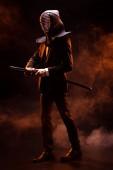 """Постер, картина, фотообои """"Полная длина вид истребитель кендо в формальных износа и шлем, мечом бамбука на темном"""""""